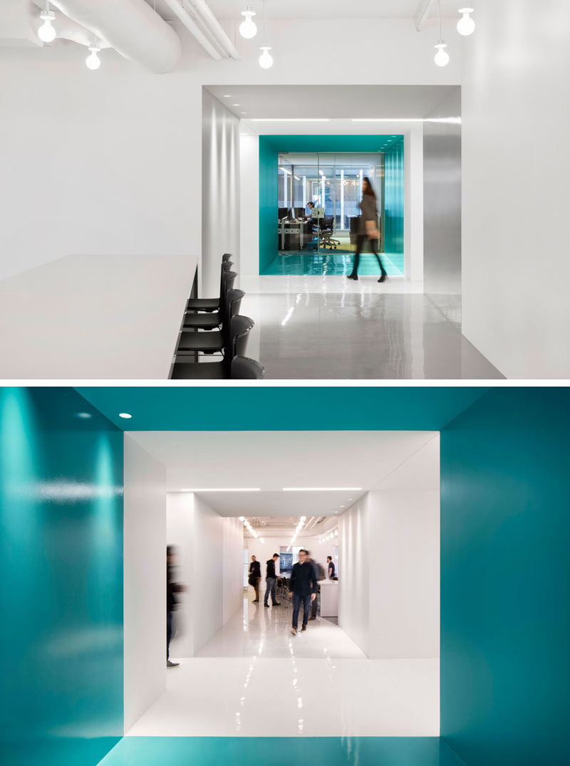 This contemporary and open-concept office design is mostly white, however bold pops of color have been used to define various areas throughout the interior. #Workplace #OfficeDesign #InteriorDesign #Office #Colors