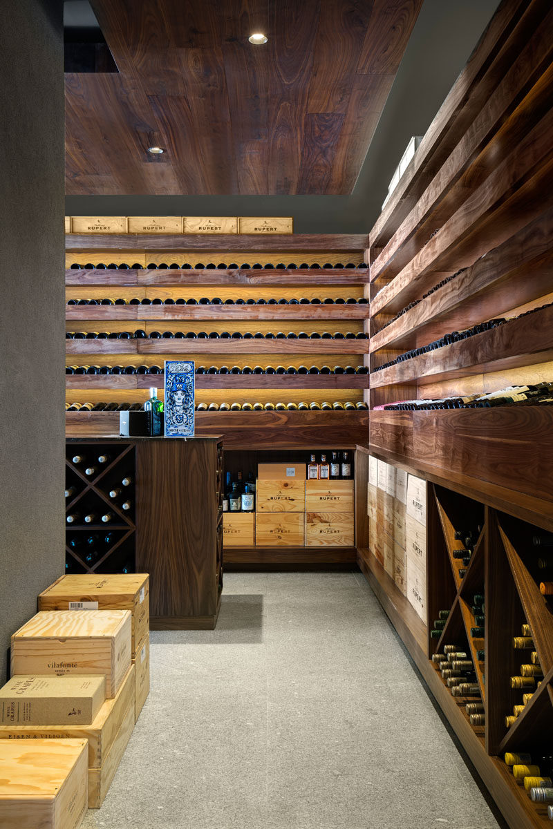 As this modern house is all about entertaining, there's a wine cellar, with wooden shelves specifically designed to show off the home owner's wine collection.