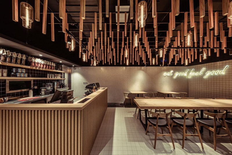 For the interior of this modern coffee shop, the designers took their inspiration from nature. The wanted to create a calm and relaxing place for the customers where they could gather and feel like they are relaxing under the trees, emulating the comforts and tranquility of an open forest canopy.