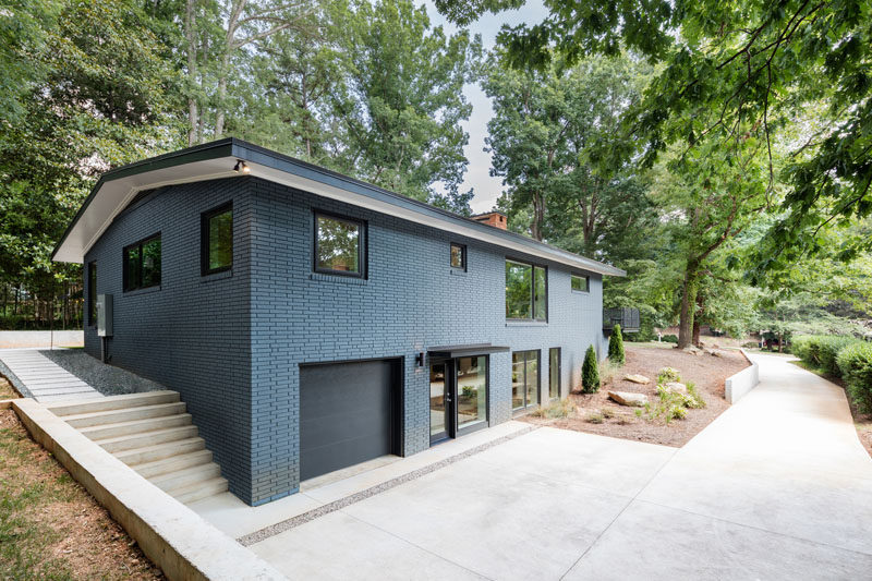 This mid-century modern brick house was updated with a bold blue painted brick exterior.