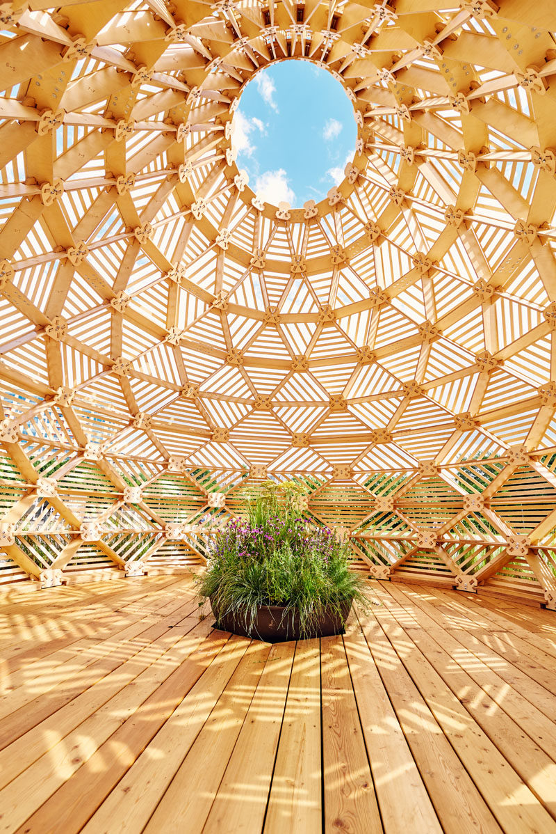 Russian designer Vlad Kissel, has created a modern wood pavilion in Moscow, Russia, that has a drop like shape that references early Slavonic aesthetics.