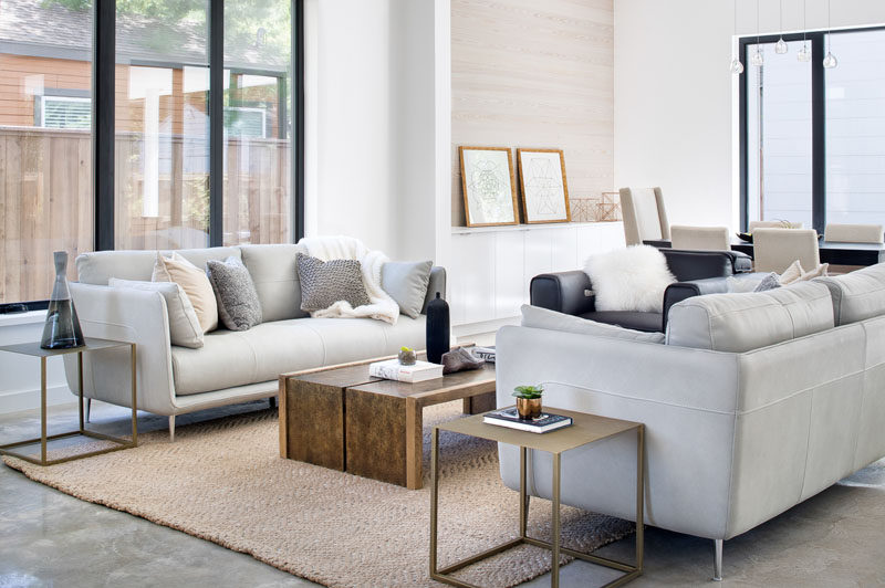 Stepping inside this modern house, the interior has been designed to be light and airy, creating a calm and relaxing environment. #LivingRoom #ModernLivingRoom #InteriorDesign #Interiors