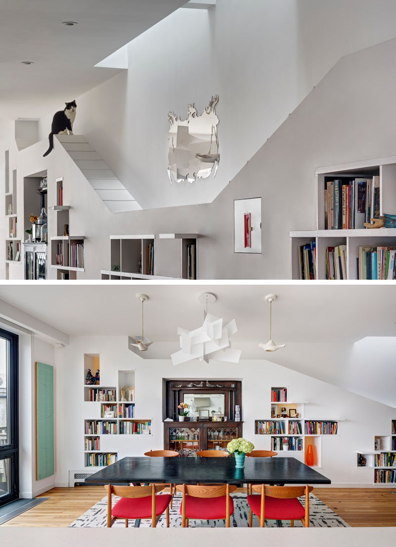 This renovated row house in Brooklyn has a custom built-in bookcase that runs the entire length of the home and it was specifically designed to allow the home owner's cats to climb it and have space to explore. #Cats #InteriorDesign #Shelving #Bookshelf #Bookcase