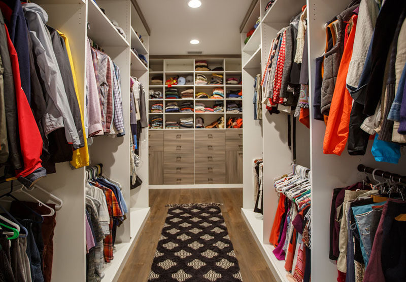 This large walk-in closet with floor-to-ceiling storage. #WalkInCloset #InteriorDesign #Closet #Storage