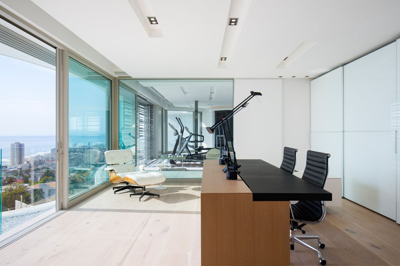 This modern house has a home office with views of the skyline and gym next door. #ModernHomeOffice #Study