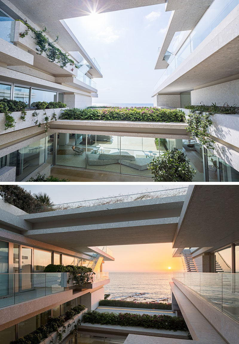 The design of this modern beach house has a central staircase that's open and as it travels down to a common reception area, it provides picture perfect views of the sea and shows off the many plants on display. #Architecture #ModernHouse