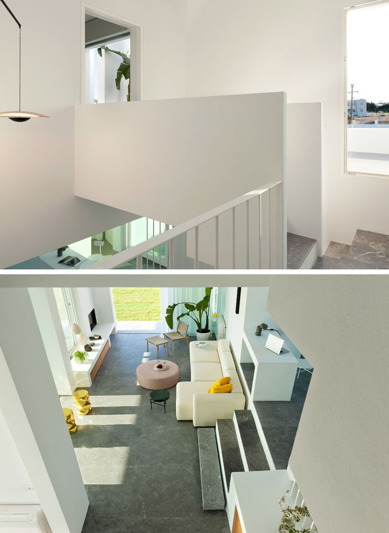These modern white stairs provide a view of the living room from above and a small bridge connects to the master bedroom. #Architecture #InteriorDesign