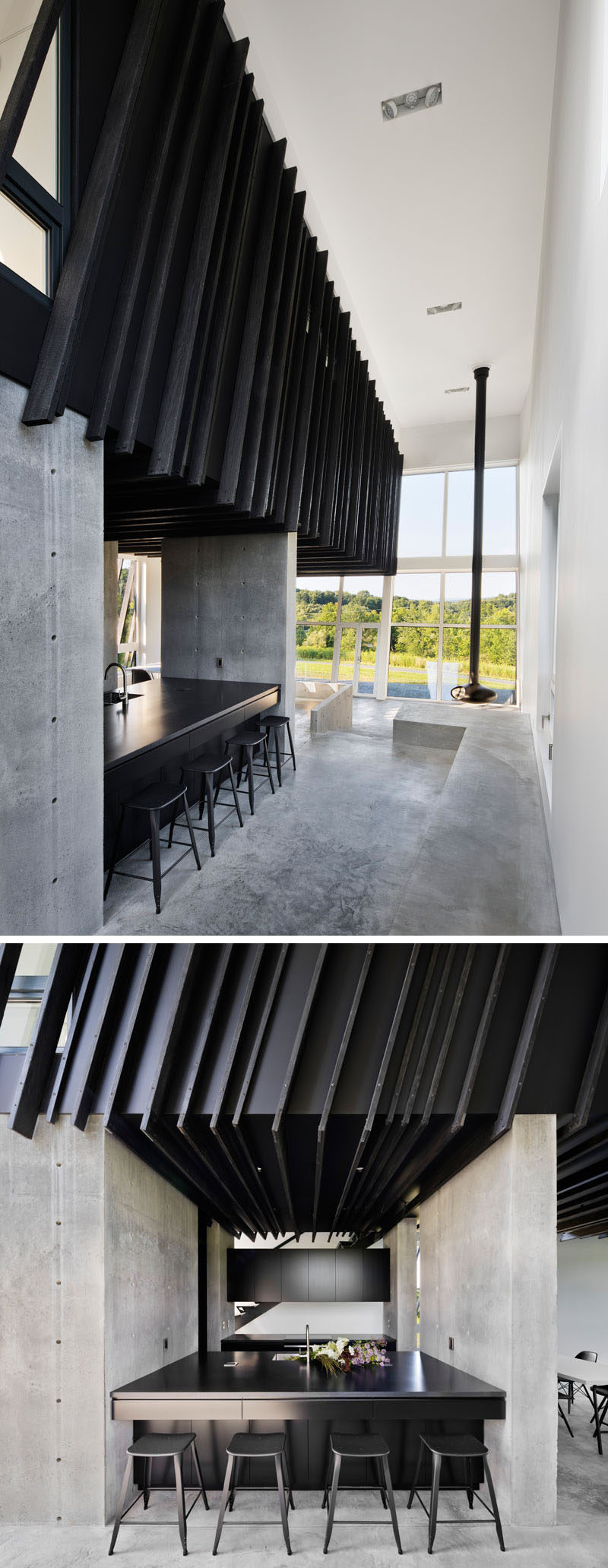 Inside this modern house, which was designed as a weekend escape from the city, the Shou Sugi Ban siding continues and creates a strong contrast to the white walls and polished concrete flooring. In the kitchen, minimalist black cabinets and countertops compliment the other black details in the interior. #ShouSugiBan #ModernHouseInterior #ConcreteFlooring #BlackKitchen