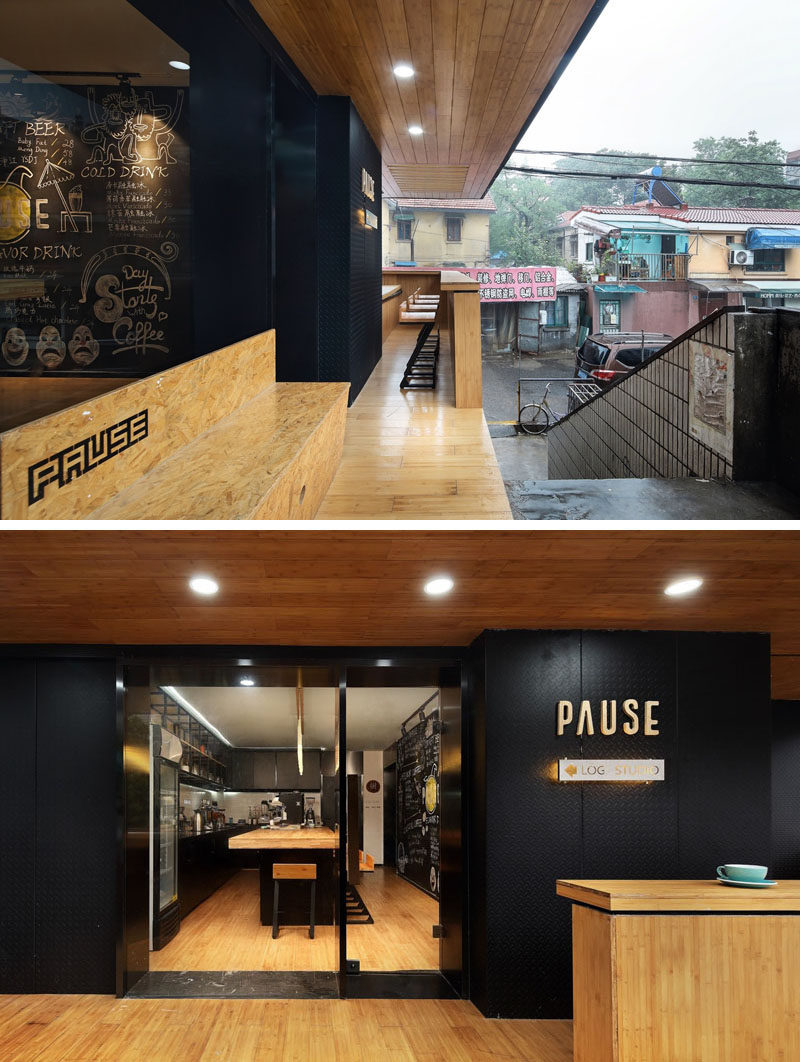 After climbing some stairs up to this modern coffee shop, there's a covered wood porch, while the cafe is defined by a black entrance. #CoffeeShop #Cafe #ModernCoffeeShop #RetailDesign #InteriorDesign