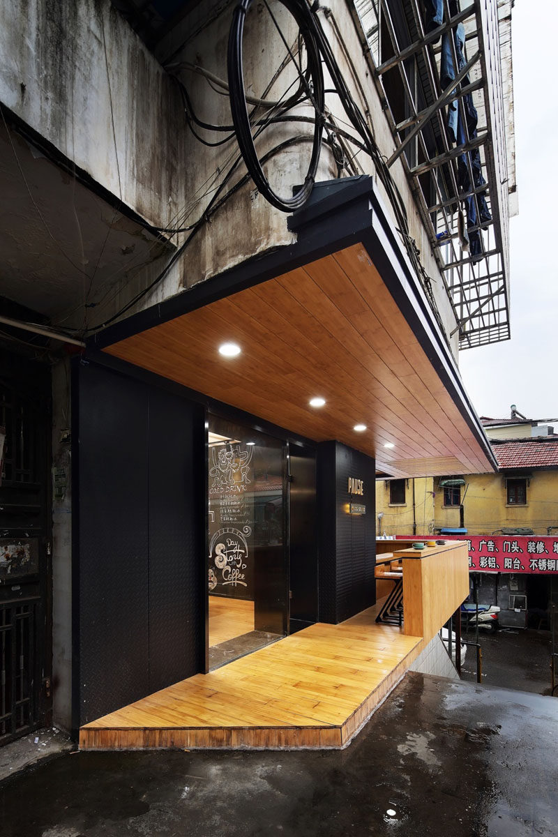 This modern coffee shop, full of matte black and bamboo elements, is nestled within a 1980s apartment building in China. #CoffeeShop #Cafe #ModernCoffeeShop #RetailDesign #InteriorDesign #Architecture
