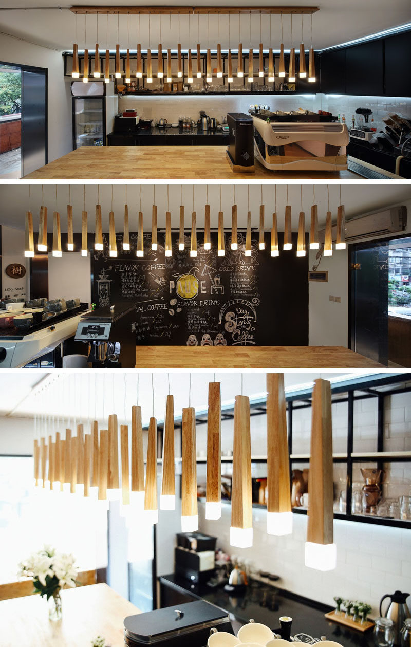 Hanging above the service bar in this modern coffee shop is an artistic lighting feature made from bamboo that has the ends lit up. #Lighting #CoffeeShop #Cafe #ModernCoffeeShop #RetailDesign #InteriorDesign