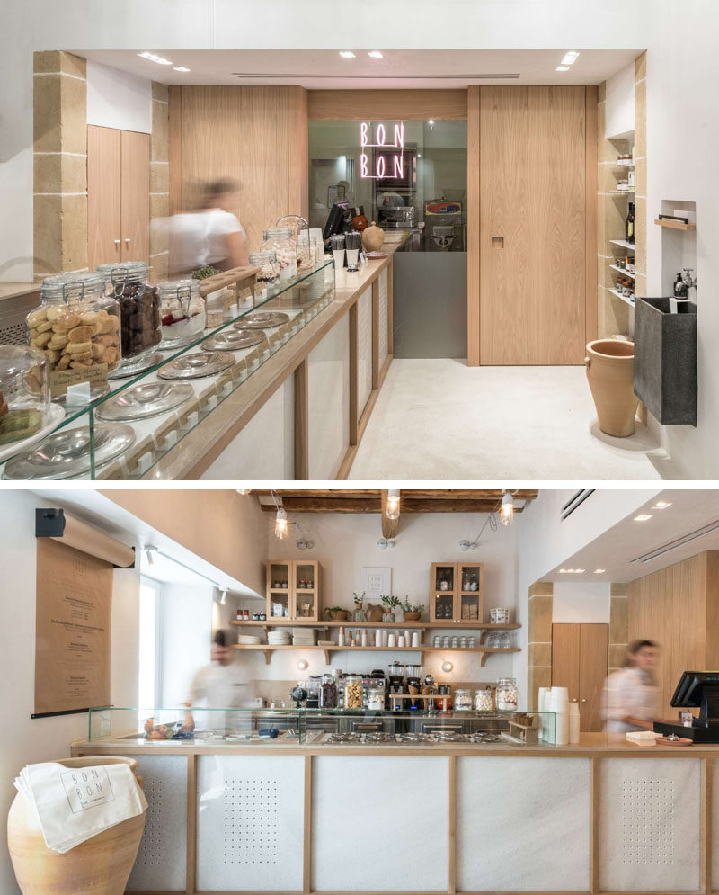 The interior of this modern cafe has been set up with a service counter that leads from the front door to the back wall. #Cafe #CafeDesign #InteriorDesign #RetailDesign