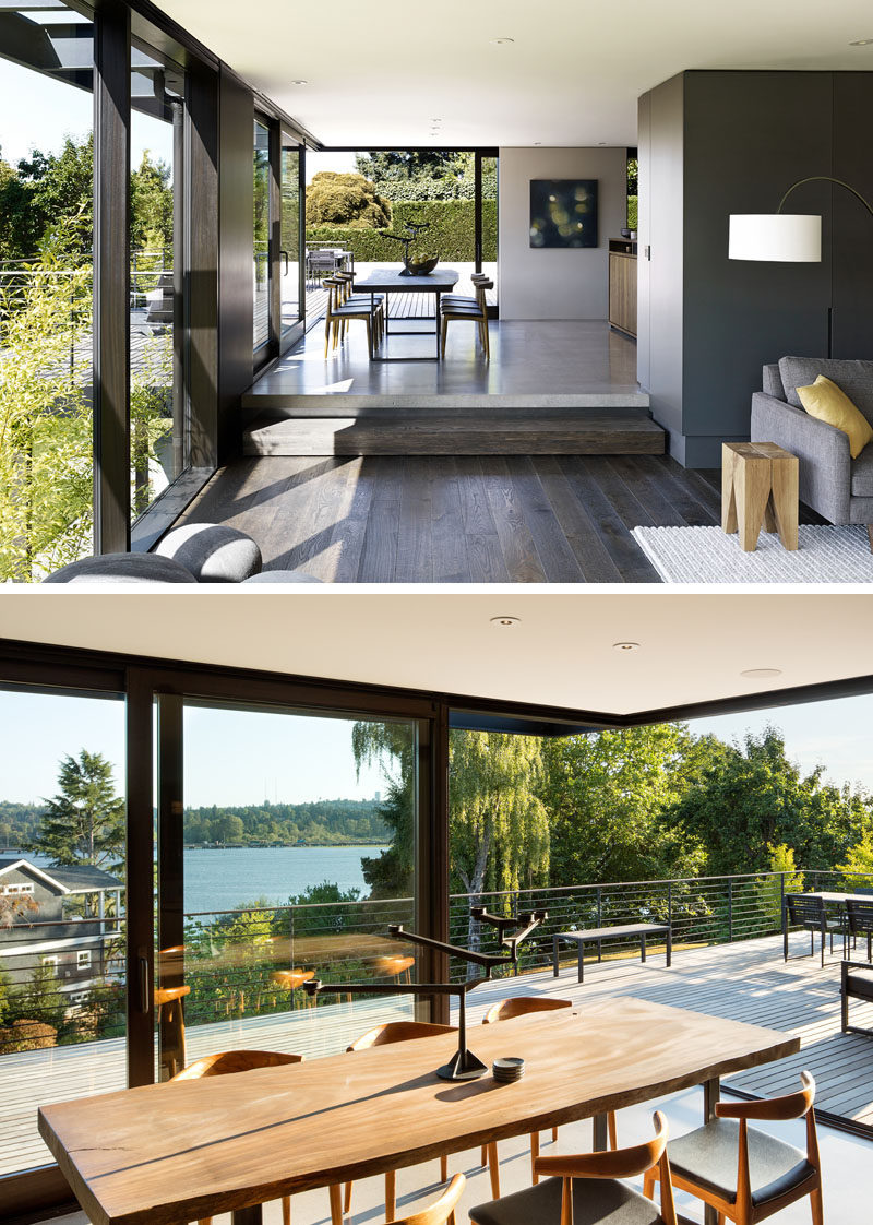 Around the corner from this modern living room is the dining room that opens up to an outdoor entertaining deck with lake views. #ModernDiningRoom #Windows