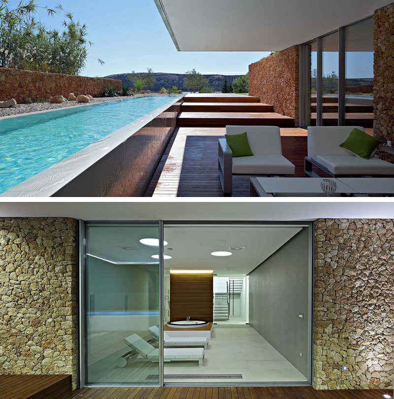 This modern house has a covered deck sits that beside the pool and next to a gym with spa. #Gym #ModernArchitecture #SwimmingPool #Deck