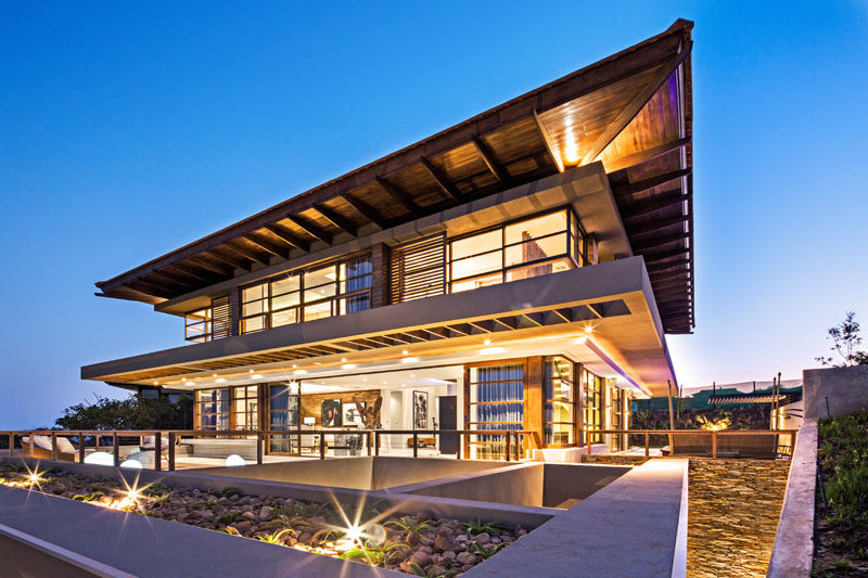 This modern house was designed in accordance with Feng Shui principles, with the shape, position, orientation of all the spaces and bodies of water all reflecting this. #FengShui #Architecture #ModernHouse