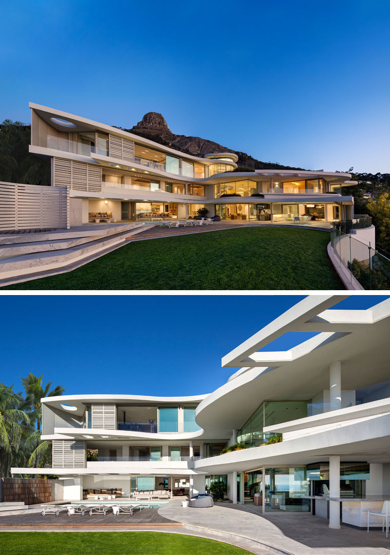 This modern house has three storeys and a large outdoor entertaining area with a landscaped yard and swimming pool. #ModernHouse #ModernArchitecture #HouseDesign