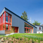 This New House In Seattle Was Designed With A Large Sloping Roof And Double Height Windows