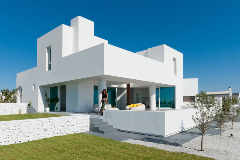 This house with sea views sits on a sloped site on the for Modern house website