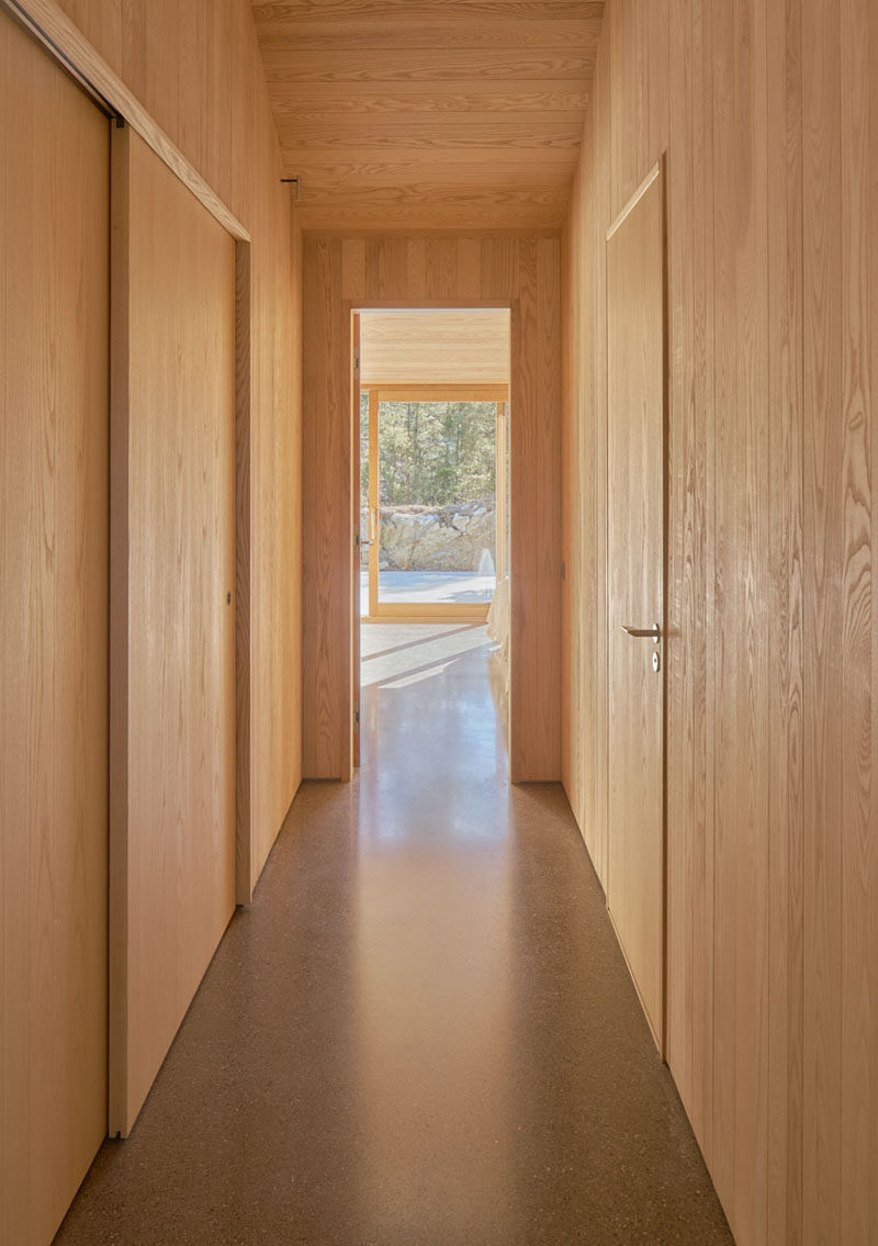 In this Scandinavian holiday house, the doors blend in to their wooden surrounds. #Scandinavian #InteriorDesign #Hallway