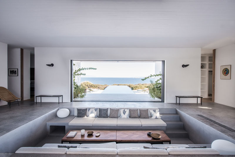 This house has a sunken living room that allows for uninterrupted ocean views contemporist for Built in designs living room