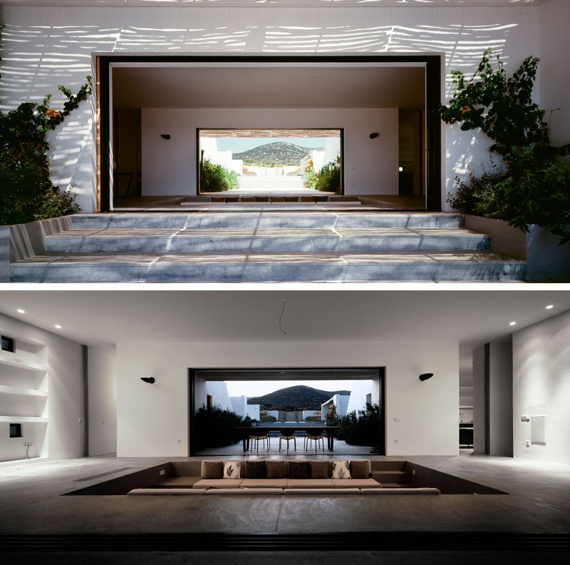 This modern summer house in Greece has a sunken living room with built-in furniture, that allows for uninterrupted views throughout the house. #SunkenLivingRoom #LivingRoom #InteriorDesign #ModernHouse