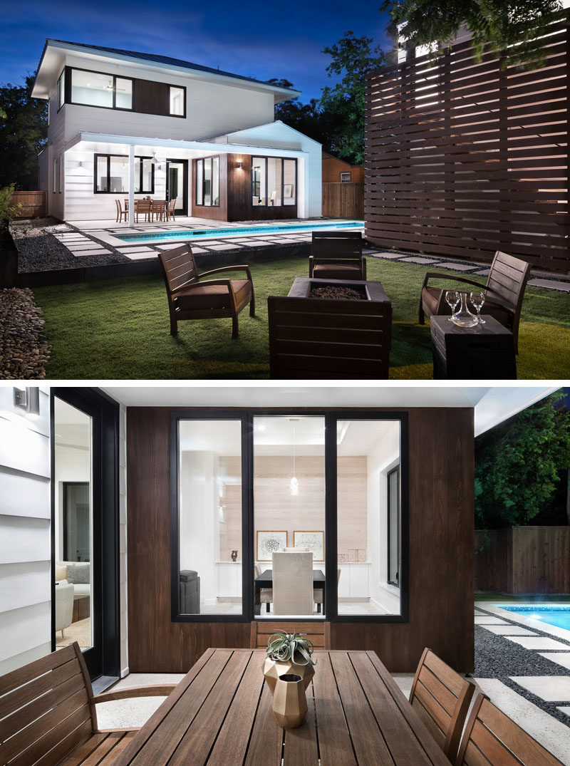 The backyard of this modern house has a covered outdoor dining area just off the living room, lap pool and a fire pit with seating, all perfect for entertaining guests. #Landscaping #Backyard #LapPool #OutdoorDining #Firepit