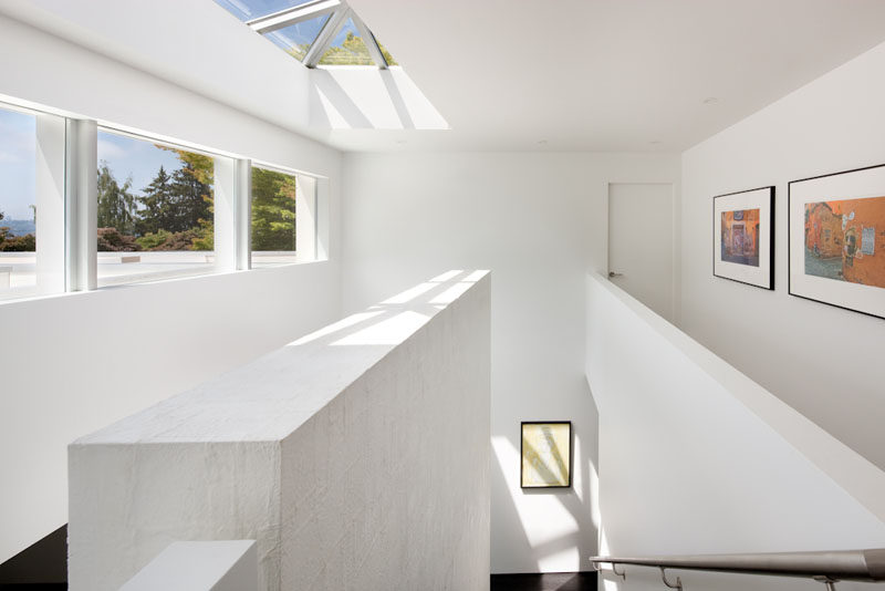 Skylights, windows and white walls make this interior feel bright and airy. #Skylight #Windows #InteriorDesign
