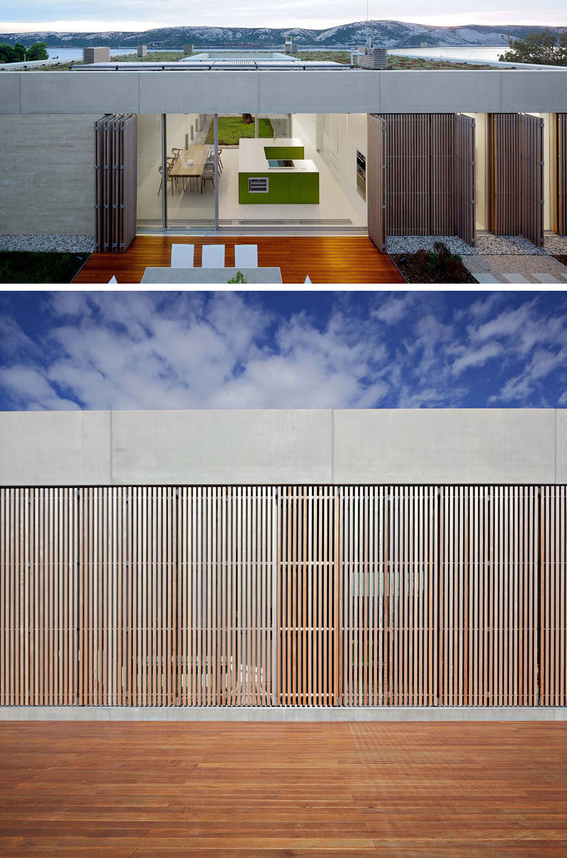 At night, vertical cedar wood brise-soleils can be closed to provide some privacy and security to this modern house. #Architecture #Screens #Shutters #ModernHouse
