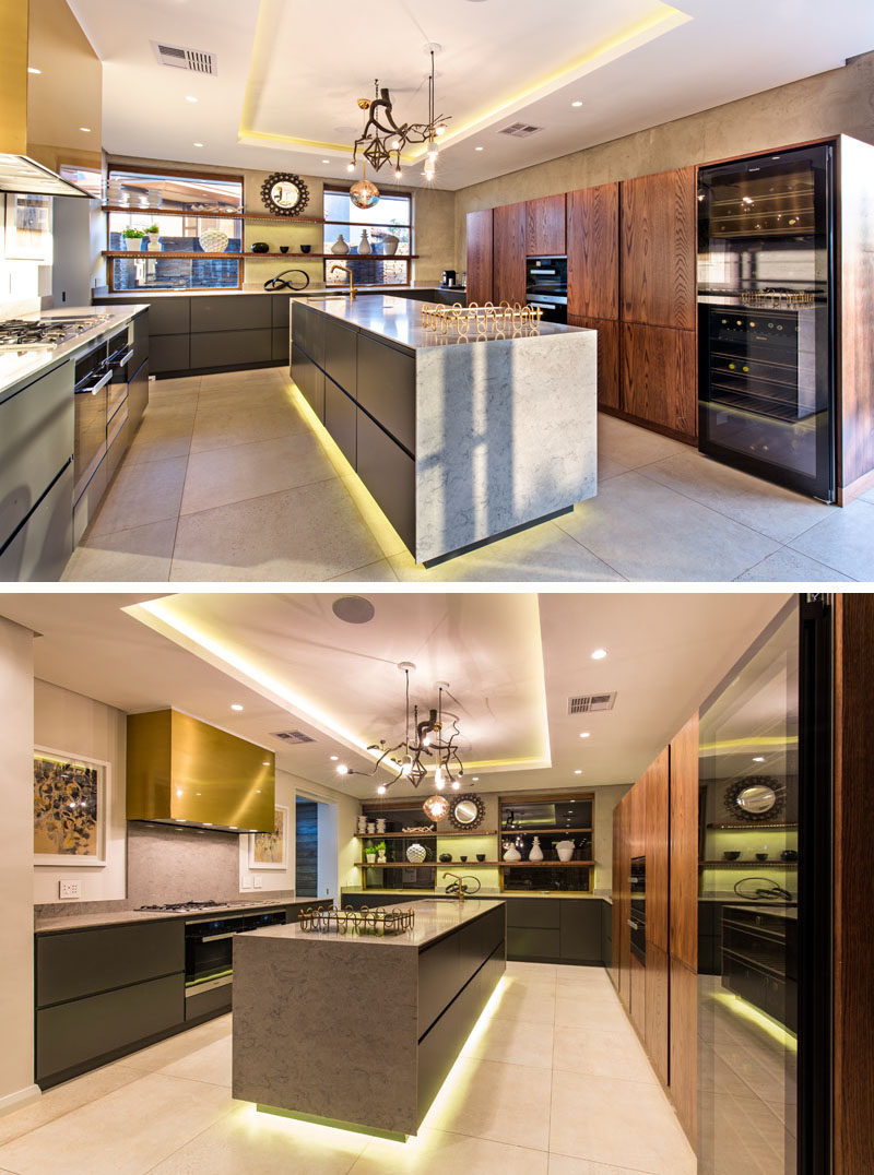 In this modern kitchen there's hidden lighting in the recessed ceiling as well as under the the kitchen island. #HiddenLighting #ModernKitchen #KitchenDesign