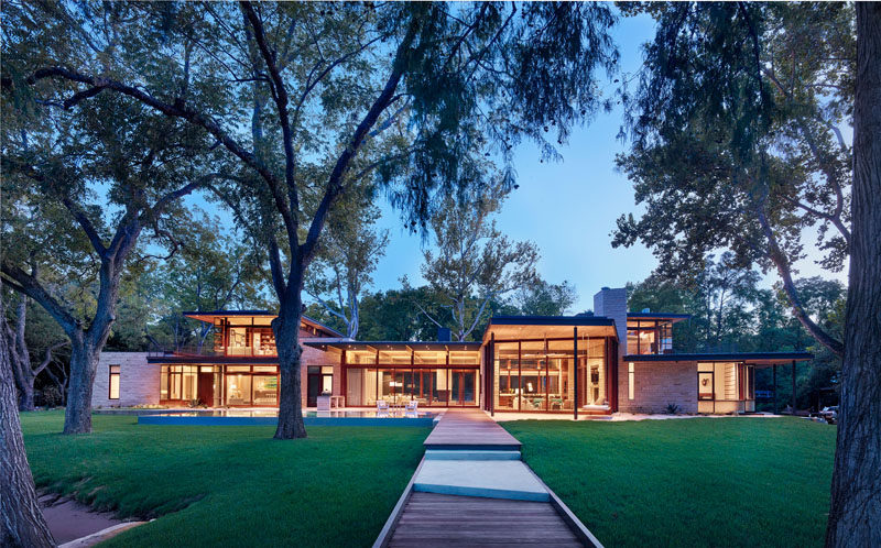 A Parallel Architecture have designed this modern wood, limestone and glass house that sits lakeside in Austin, Texas. #ModernArchitecture #ModernHouse