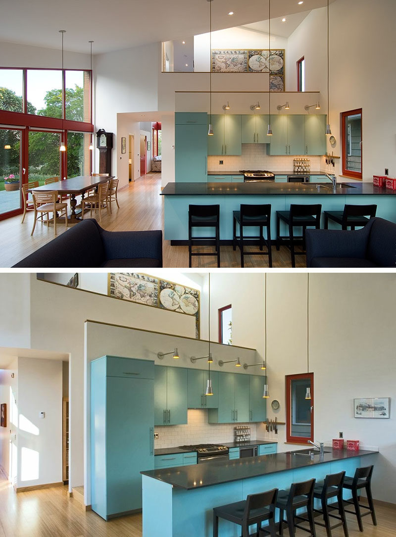 Soft blue kitchen cabinets in this modern kitchen add a pop of color to the open floorplan. #InteriorDesign #BlueKitchen #BlueCabinets #KitchenDesign