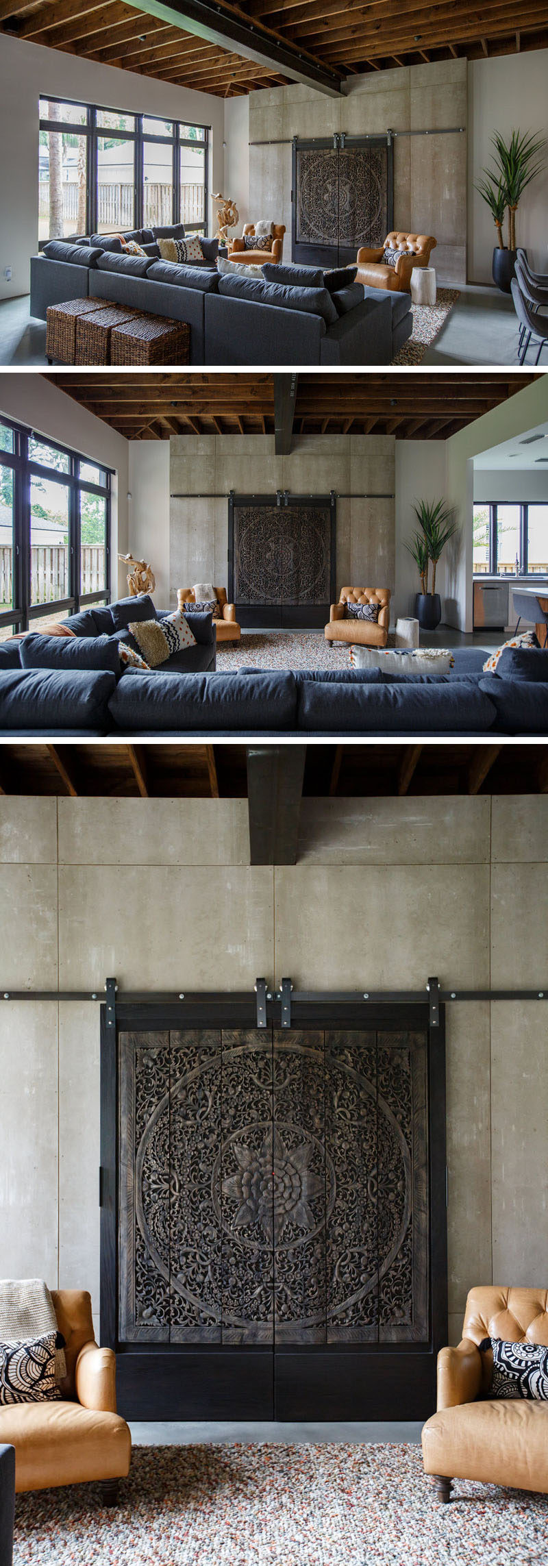 In this modern living room, artistic carved wood panels on a simple metal track hide the television from view when it's not in use. #LivingRoom #InteriorDesign #ArtisticPanels #HideTV