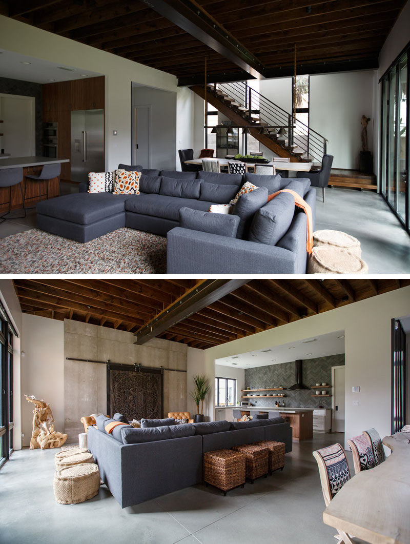 This modern house interior features exposed wood and steel beams that draw the eye upwards to make the room feel large and spacious. #InteriorDesign #ExposedCeiling #ModernInteriorDesign
