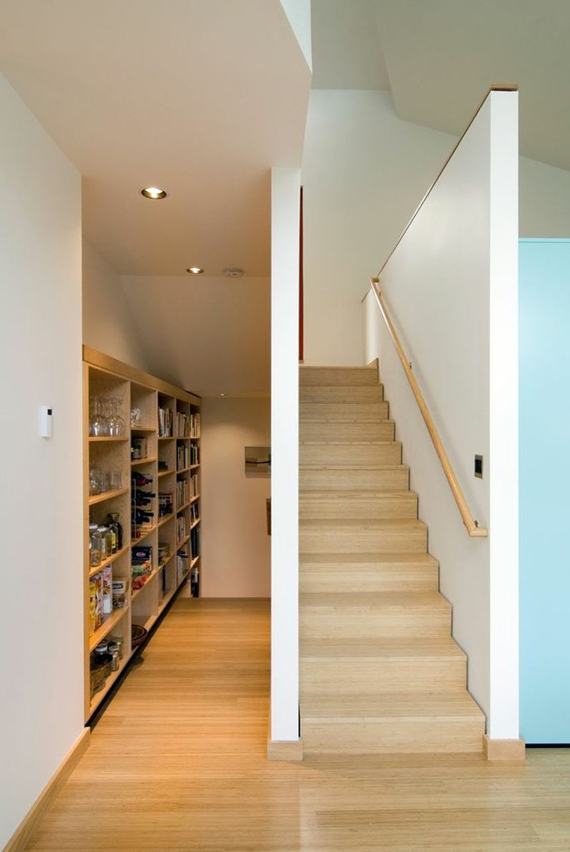 Located in a small alcove next to the stairs and kitchen is a small pantry and storage area. #Pantry #Storage #InteriorDesign