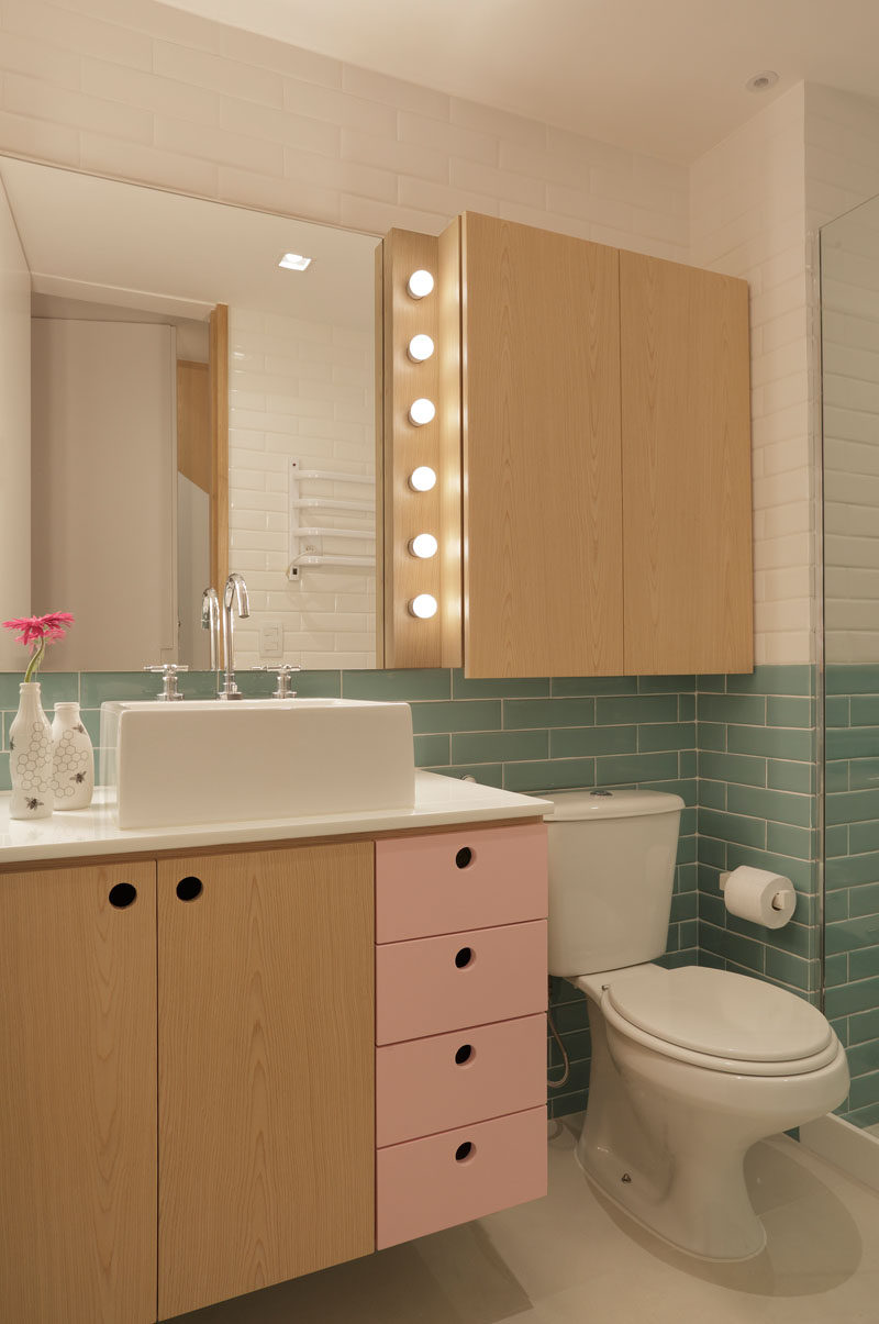 This modern bathroom uses soft colors combined with light wood and white walls. #ModernBathroom #BathroomDesign