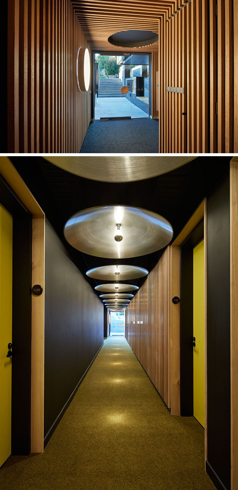 Inside this modern apartment building's entrance are wooden slats that cover the walls and ceiling, while circular elements can be found throughout the interior, like in the hallway, where the designers have used discs mounted to the ceiling to reflect the light of single bulbs. #Lobby #Hallway #WoodSlats #ModernLighting