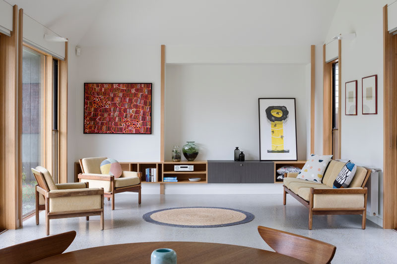 This contemporary living room has built-in wood storage that matches the wood frames found throughout the house. #LivingRoom #LivingRoomStorage #Wood