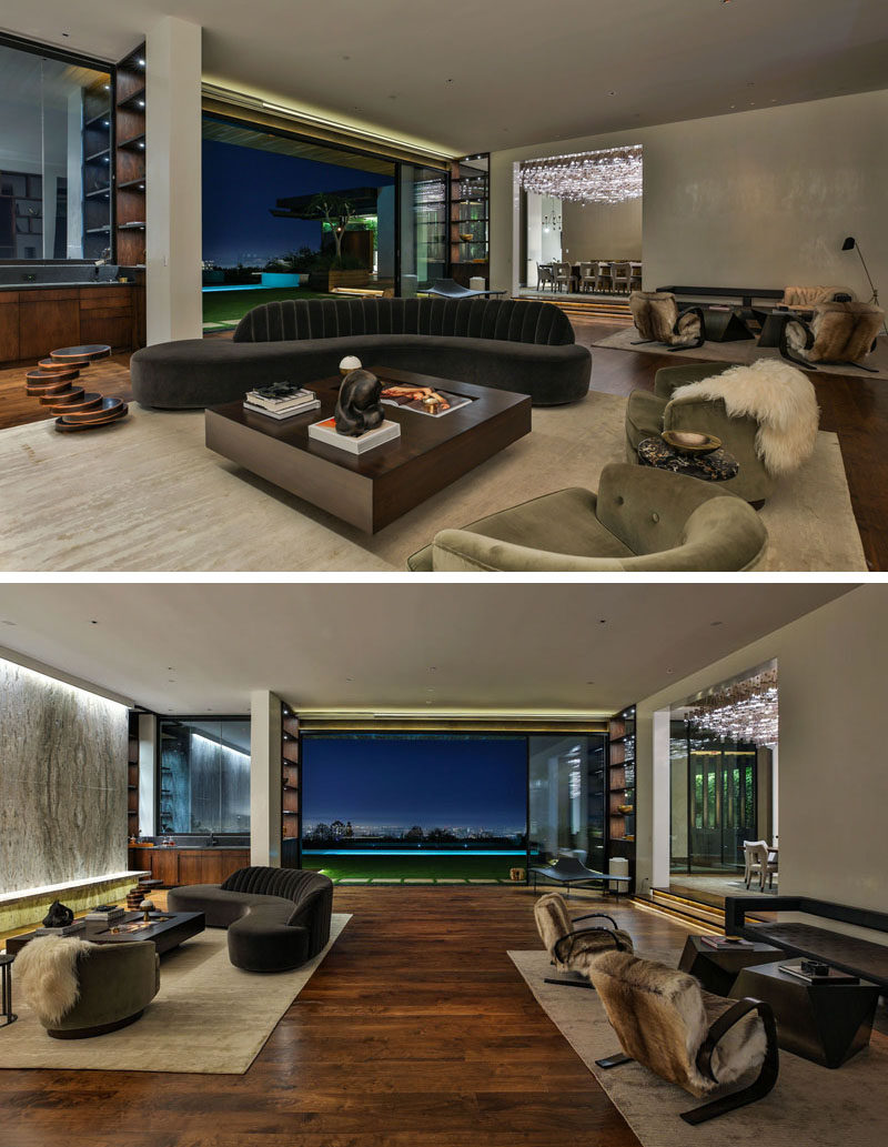 Inside this modern house, the interiors are a mixture of warm materials such as natural wood, copper, limestone, marble and a touch of exposed steel to create a warm, industrial, sophisticated environment. #InteriorDesign #LivingRoom