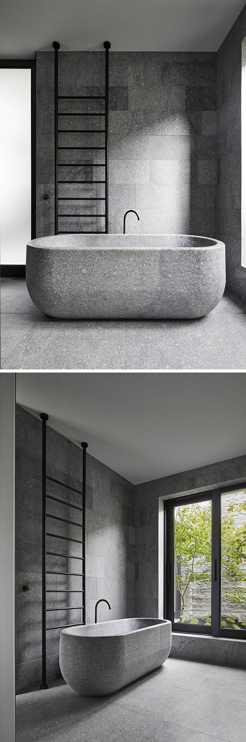 In this modern bathroom, a freestanding bathtub has been carved from a single granite block. Black accents like the faucet and towel ladder tie in with the window frames and create a contrast to the grey granite stone. #ModernBathroom #GraniteBathtub #GreyGranite
