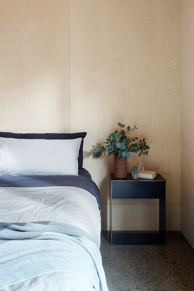 Light plywood has been used for the walls in this minimalist bedroom. #Plywood #ModernBedroom #BedroomDesign