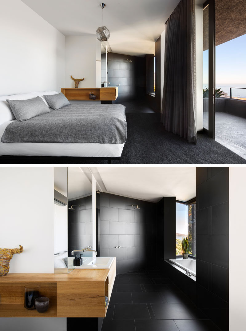 In this modern bedroom, black carpets contrast the white walls and bed, while a black en-suite bathroom with a built-in bathtub is open to the rest of the room. #BlackCarpet #ModernBedroom #EnsuiteBathroom #BlackBathroom