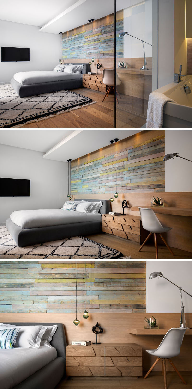 In this modern bedroom, an accent wall has been created using reclaimed timber cladding, while a built-in wood desk is combined with the headboard. An en-suite bathroom sits off to the side and is enclosed within glass frame. #WoodAccentWall #ModernBedroom #InteriorDesign