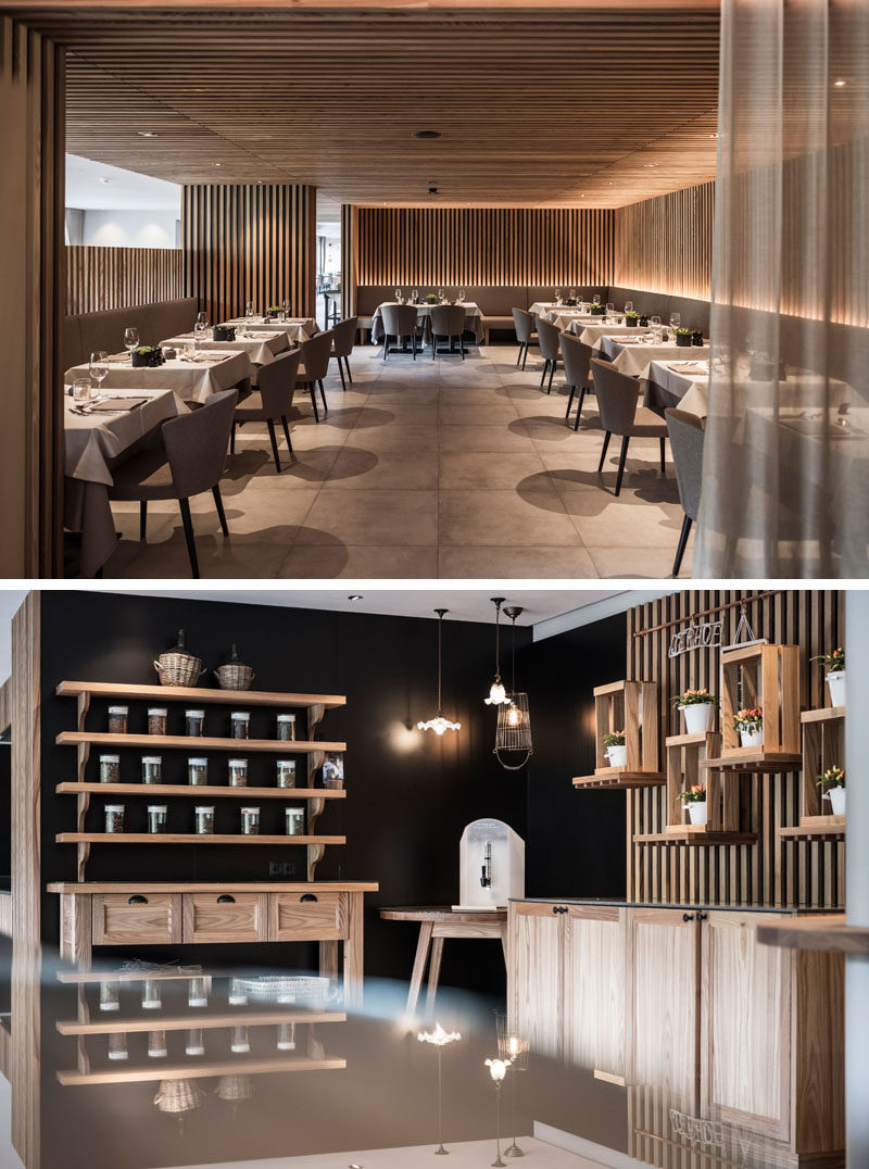Wood slats cover the walls and ceiling in this modern hotel dining room, and hidden lighting highlights the design and creates a relaxing atmosphere. #ModernRestaurant #Wood #HotelDesign #HotelInterior