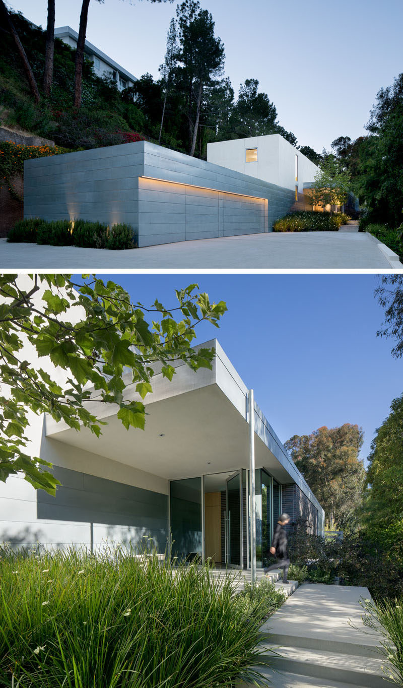 Upon arriving at this modern house, you are greeted by a large garage and a small garden with a path that leads to the glass front door. #ModernHouse #ModernGarage #Landscaping