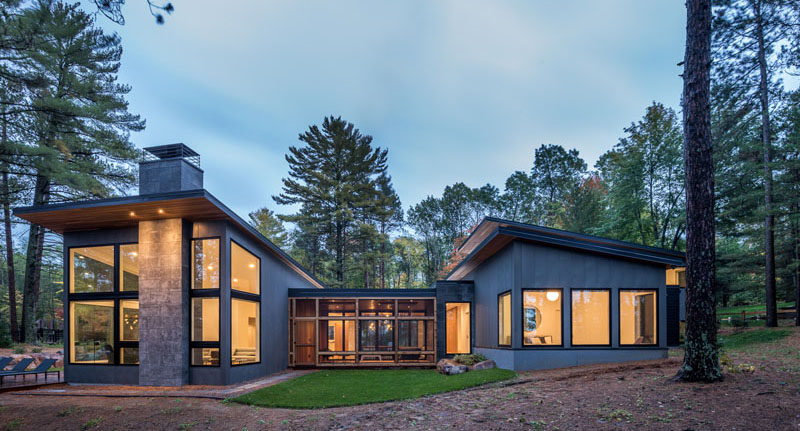 Strand Design have recently completed a new modern, vacation lake home in northern Minnesota, for a young couple that combines their appreciation of Scandinavian architecture and their active lifestyle, and at the same time, celebrates the natural woods environment. #ModernHouse #HouseDesign #ModernArchitecture