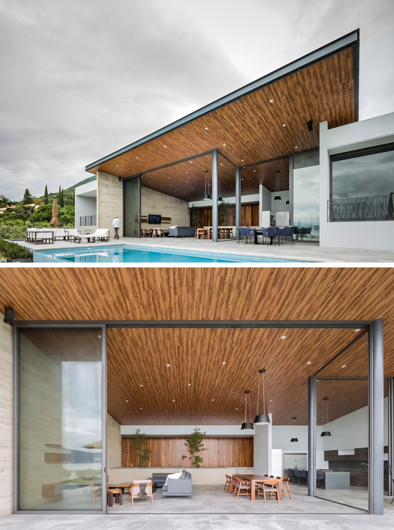This Home Was Designed With A High Sloping Roof That Allows Large Windows To Capture The Lake Views