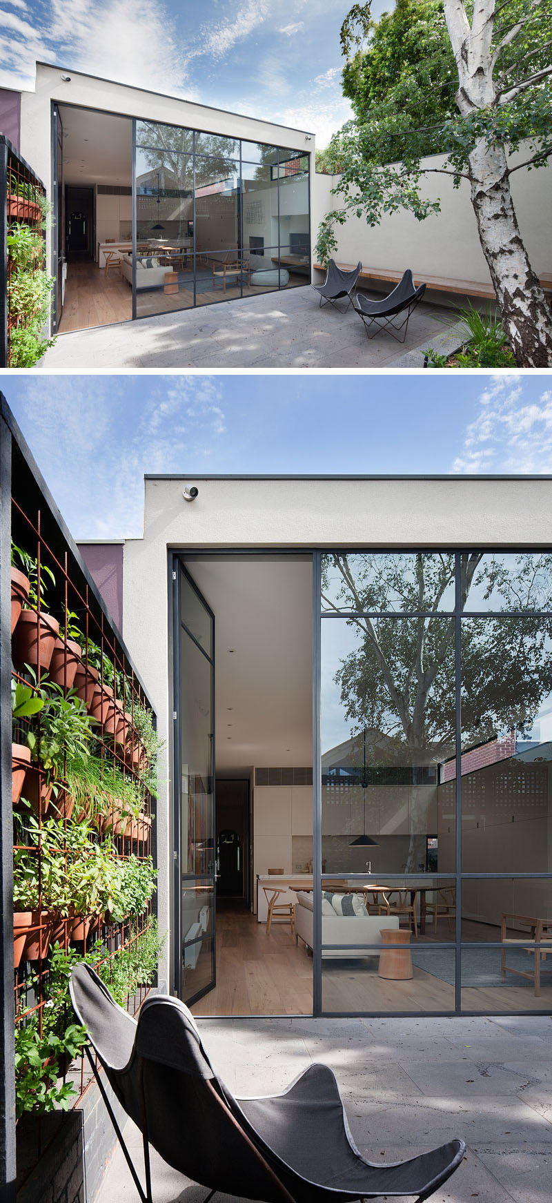 In this modern courtyard, a high wall and black fence provide privacy from the neighbors. A built-in bench and a couple of outdoor chairs create spaces to relax, and built-in planters and a wall of potted plants add a touch of nature. #Landscaping #Courtyard #PlantWall #Windows