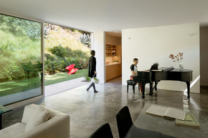 Inside this modern guest house, there's a living room / music room and the large sliding glass door allows plenty of daylight to enter the interior. #SlidingGlassDoor