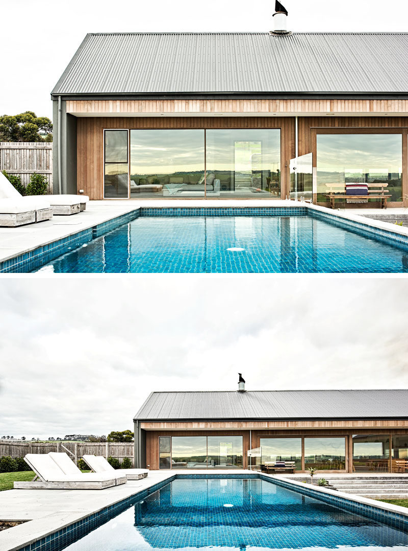 This modern ranch-inspired house, has a pool that sits at the same level as the interior living room. #SwimmingPool #ModernHouse