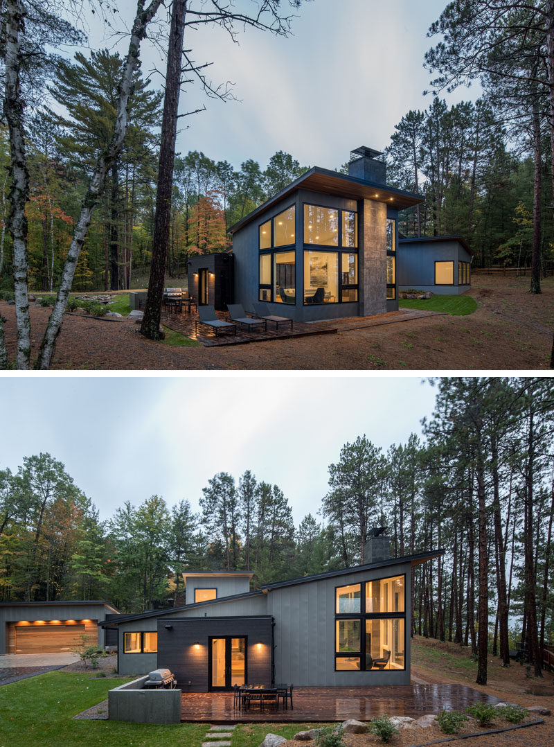 This modern house that's surrounded by trees, has an outdoor patio that's been set up with a bbq, outdoor dining and sun lounges. #Patio #ModernHouse #ModernArchitecture